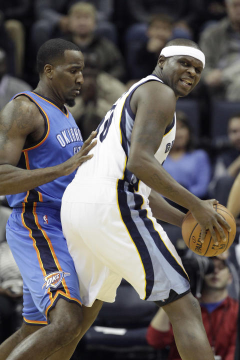 Memphis Grizzlies' Zach Randolph, right, is pressured by Oklahoma City Thunder's Kendrick Perkins, left, in the first half of an NBA basketball game in Memphis, Tenn., Wednesday, Dec. 11, 2013