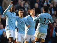 Manchester City midfielder Yaya Toure (L) celebrates with Sergio Aguero, James Milner and Carlos Tevez after scoring the opening goal of the fifth round English FA Cup football match against Leeds in Manchester on February 17, 2013. Manchester City&#39;s won 4-0