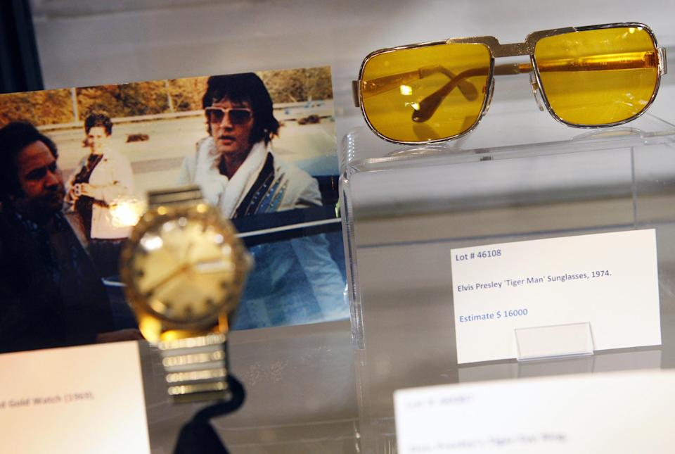 "These items were part of the Ultimate Elvis Auction II held Wednesday Aug. 14, 2012, at the Peabody Hotel in Memphis, Tenn. The ""Tiger Man"" sunglasses sold for $16,000. (AP Photo/Alan Spearman, The Commercial Appeal)"