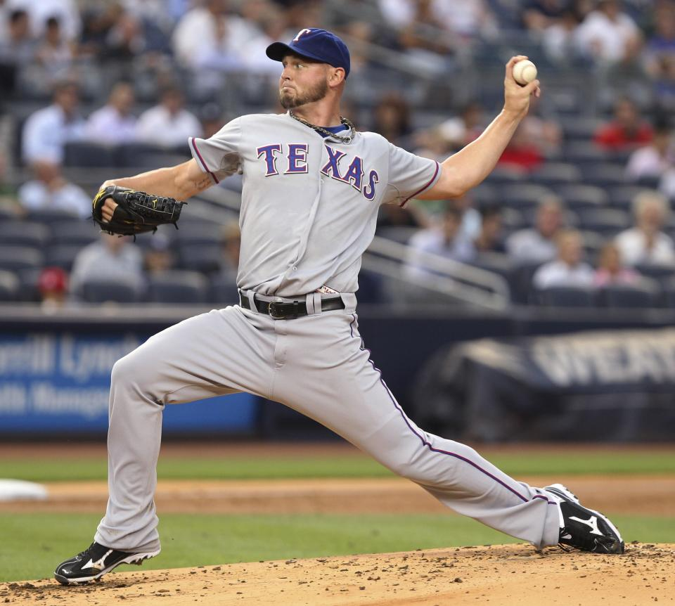 Texas Rangers' Matt Harrison pitches during the second inning of a baseball game against the New York Yankees on Tuesday, Aug. 14, 2012, at Yankee Stadium in New York. (AP Photo/Seth Wenig)