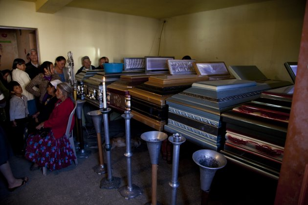 Relatives attend a funeral service for the Vazquez family in San Cristobal Cucho, Guatemala, Thursday, Nov. 8, 2012. The family died when a magnitude 7.4 earthquake struck on Wednesday, collapsing their home and burying 10 members of the family including a 4-year-old child, in the rubble. (AP Photo/Moises Castillo)