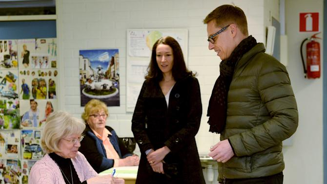 Finnish Prime Minister Alexander Stubb and his wife Suzanne Innes-Stubb cast their votes in Espoo, Finland, Sunday April 19, 2015. Finns are voting in parliamentary elections that will determine which coalition of parties can lead the country out of a three-year recession. (Mikko Stig/Leutikuva via AP) FINLAND OUT