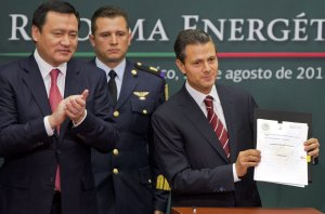 Mexico's President Enrique Pena Nieto, right, shows …