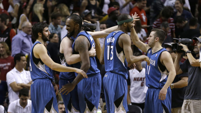 Minnesota Timberwolves players celebrate their 122-121 win against the Miami Heat in double overtime of an NBA basketball game in Miami, Friday, April 4, 2014. (AP Photo/Alan Diaz)