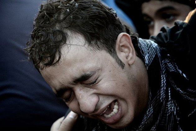 A Bahraini man mourns during the funeral of 16-year-old Ali Abbas Radhi in the village of Samahij, Muharreq City, east of capital Manama on November 10, 2012. The Shiite Muslim teenager died after he