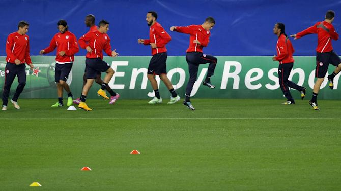 Olympiakos' players run during a training session at the Vicente Calderon stadium ahead of Wednesday's Champions League soccer match between Atletico de Madrid and Olympiakos,  in Madrid, Spain, Tuesday, Nov. 25, 2014