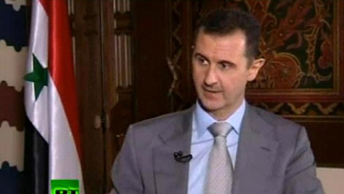 "FILE - In this file image made from video, Syrian President Bashar Assad speaks with English-language television channel Russia Today recorded at an unknown date in Damascus, Syria. Assad vowed to ""to live in Syria and die in Syria"", declaring in an interview broadcast Thursday, Nov. 8, 2012 that he will never flee his country despite the bloody, 19-month-old uprising against him. (AP Photo, File) RUSSIA OUT TV OUT"