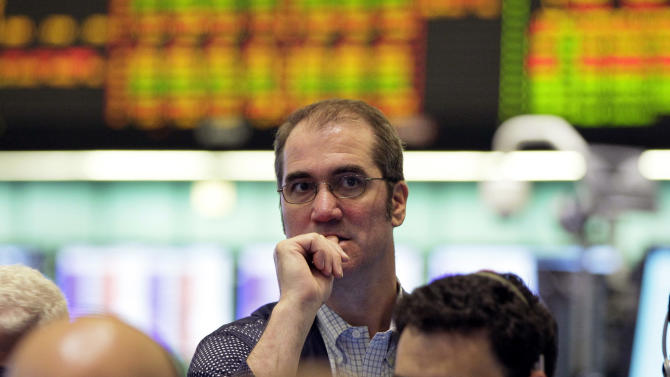 Traders work in the oil options pit at the New York Mercantile Exchange, Thursday, May 24, 2012. Oil lingered near seven-month lows around $90 a barrel Thursday in Asia as Europe's debt crisis festers and China's economy continues to slow. (AP Photo/Richard Drew)
