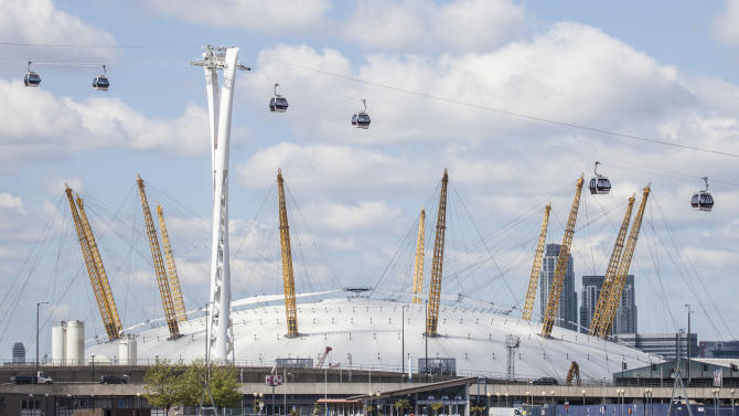 In this image made available Monday June 18, 2012 by the Transport for London the new a cable car crosses of the  River Thames past the O2 arena in Greenwich London.  Transport for London said Monday June 18, 2012 it will start operating Britain's first urban cable car at the end of June — in time for the crowds expected for the Olympics. The cable car will make the half mile (one kilometre) crossing between Greenwich and the Royal Docks starting June 28.(AP Photo/John Sturrock, Transport for London)