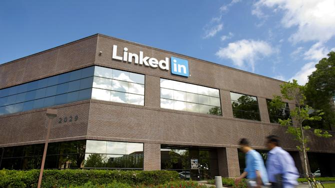 FILE - In this Tuesday, May 7, 2013, file photo, people walk past LinkedIn's Mountain View, Calif., headquarters. LinkedIn reports quarterly earnings on Tuesday, Oct. 29, 2013. (AP Photo/Noah Berger, File)