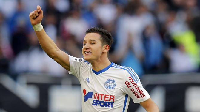 Olympique Marseille's Florian Thauvin celebrates after an own goal was scored during their French Ligue 1 soccer match against Lille at the Velodrome stadium in Marseille
