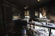 Damage inside the burnt US consulate building in Benghazi in September 2012. Armed attackers doused the outside of one of the buildings with diesel, setting it alight and then invaded the main residence, pouring fuel over furniture and starting a blaze, which let off plumes of thick, choking smoke