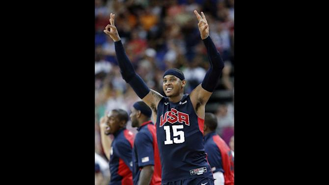 FILE - United States' Carmelo Anthony celebrates after hitting a three-point shot during a semifinal men's basketball game against Argentina at the 2012 Summer Olympics, Friday, Aug. 10, 2012, in London. The U.S. will square off against the Spaniards Sunday Aug. 12, 2012 in the rematch of the gold-medal game that produced a classic at the Beijing Olympics. (AP Photo/Eric Gay, File)