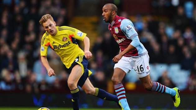 Fabian Delph (R) of Aston Villa holds off Sebastian Larsson (L) of Sunderland (Getty Images)