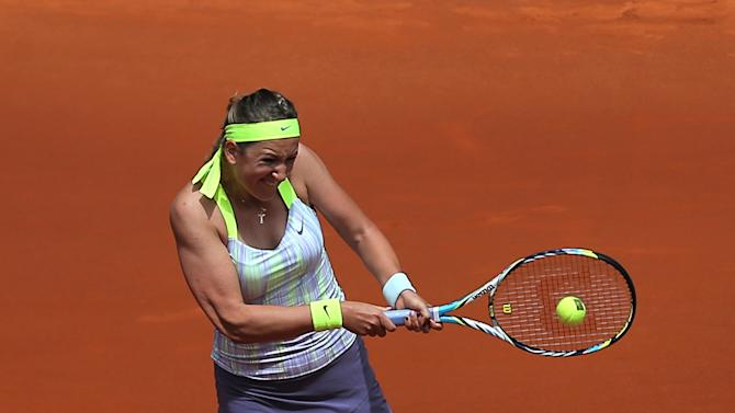 Victoria Azarenka from Belarus returns the ball during the match against Ekaterina Makarova from Russia at the Madrid Open tennis tournament, in Madrid, Wednesday, May 8, 2013. (AP Photo/Andres Kudacki)