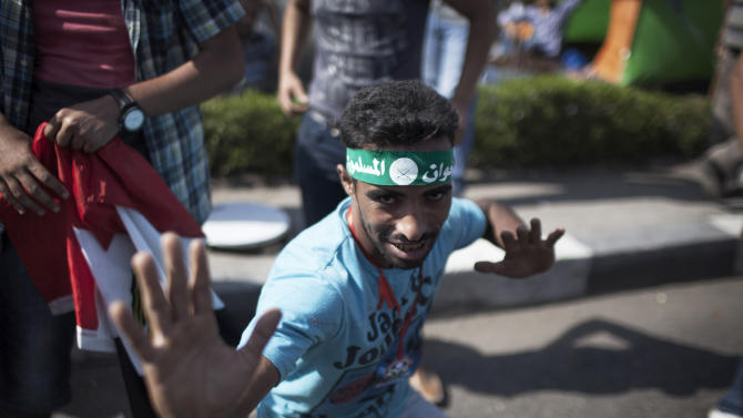 A supporter of Egypt's Islamist President Mohammed Morsi poses for a picture during a rally in Cairo, Friday, June 28, 2013. Thousands of backers and opponents of Egypt's Islamist president held competing rallies in the capital Friday and new clashes erupted between the two sides in the country's second largest city, Alexandria, in a prelude to massive nationwide protests planned by the opposition this weekend demanding Mohammed Morsi's removal. (AP Photo/Manu Brabo)