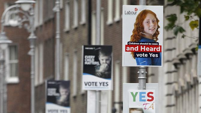 Yes posters decorate the street scene outside government buildings in Dublin, Ireland, Friday, Nov. 9, 2012, before the historic referendum on upcoming Saturday to decide on increasing legal protection for children in Ireland.  Ireland's government is asking voters to agree to insert stronger rights for children into the constitution, a measure designed to make it easier for state agencies to protect children from abuse and for neglected kids to be adopted. (AP Photo/Peter Morrison)