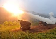 US Multiple Launch Rocket System sends rockets into the air during a live fire training exercise in the South Korean border county of Cheorwon on September 13. Some 28,500 US troops are based in South Korea under a mutual defence pact to deter against the North Korean threat