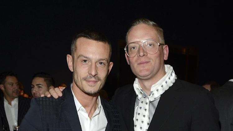 Jonathan Saunders, left, and Giles Deacon are seen at the Designer Pudsey 2012 Collection auction in association with BBC's Children in Need at Christie's Auction House on Thursday, Nov. 15, 2012, in London. (Photo by Jon Furniss/Invision for Children in Need/AP Images)