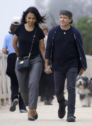 Denny Fongheiser and his girlfriend Kim Adamis power-walk in Palisades Park in Santa Monica, Calif., Sunday, Oct. 23, 2011. More doctors are going beyond standard cholesterol counts, using another test to take a closer look at the bad fats, a count of particles that carry LDL through the blood. Fongheiser's usual 3-mile-a-day walk left him suddenly panting but his insurer wouldn't pay for a stress test because his cholesterol was normal. A month later, chest pain sent Fongheiser to the hospital where he needed a stent to unclog an artery. It turned out he had high particle levels, which his cardiologist now aims to get below the LipoScience-recommended level of 1,000 with cholesterol-lowering drugs. (AP Photo/Reed Saxon)