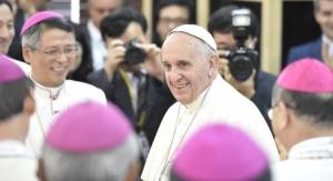 Pope Francis arrives for a meeting with the bishops at the headquarters of the Korean Bishops's Conference in Seoul
