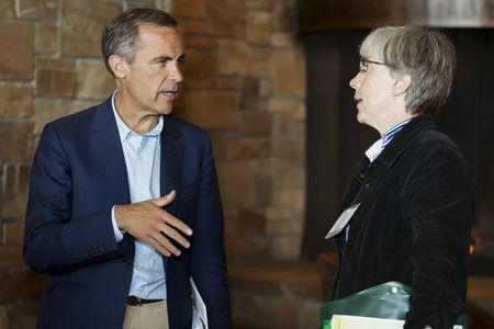 Bank of England Governor Carney talks with U.S. Department of Commerce Chief Economist Helper during the Federal Reserve Bank of Kansas City's annual Jackson Hole Economic Policy Symposium in Jackson Hole