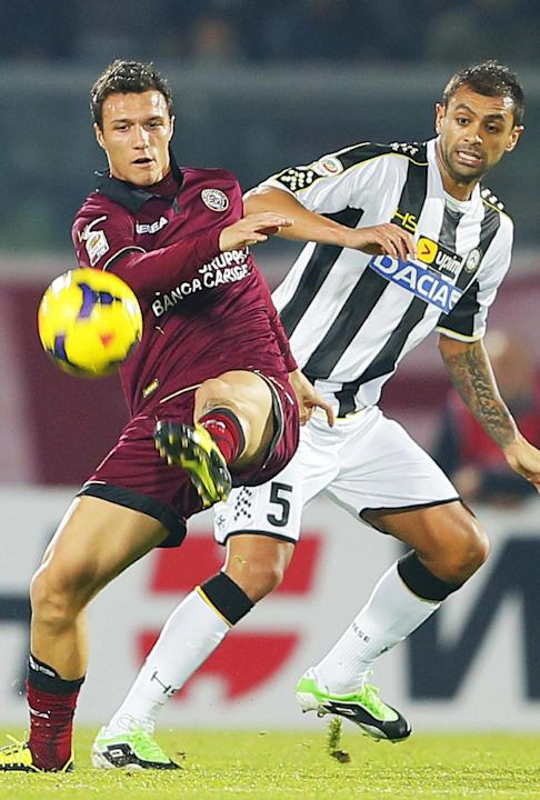 Livorno's Luca Siligardi, left, and Udinese's Larangeira Danilo, of Brazil, vie for the ball during a Serie A soccer match between Livorno and Udinese, in Leghorn, Italy, Saturday, Dec. 21, 20
