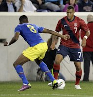 United States midfielder Danny Williams, right, moves the ball against Ecuador defender Fricson Erazo in the first half of an international soccer friendly game, Tuesday, Oct. 11, 2011, in Harrison, N.J. (AP Photo/Julio Cortez)