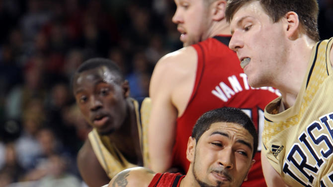 Louisville guard Peyton Silva, left, drives the lane as Notre Dame forward Jack Cooley defends during the first half of an NCAA college basketball game Saturday, Feb. 9, 2013 in South Bend, Ind. (AP Photo/Joe Raymond)