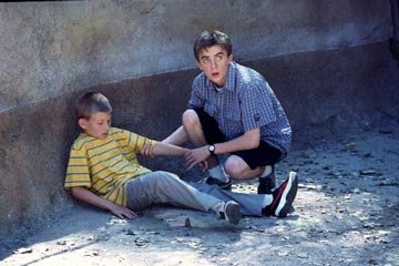 Dewey (Erik Per Sullivan, L) and Malcolm (Frankie Muniz) in Fox's Malcolm In The Middle