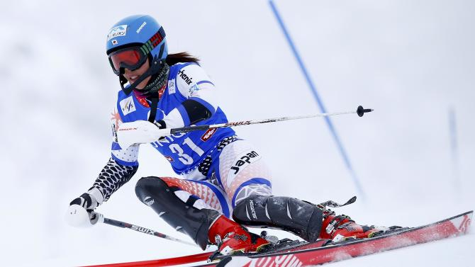 Hasegawa from Japan clears a gate during the first run of the World Cup Women's Slalom race in Kuehtai ski resort