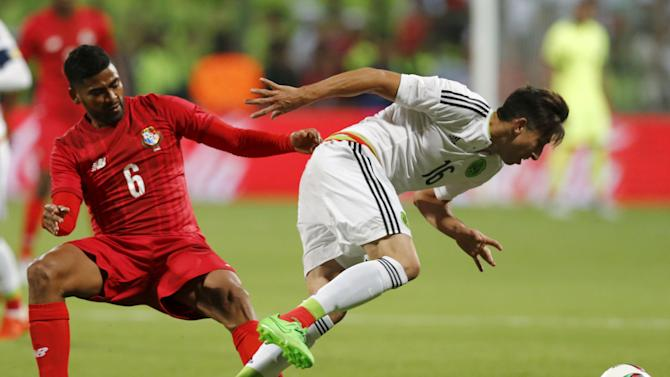 Hector Herrera of Mexico battles for the ball with Gabriel Gomez of Panama during a friendly soccer match, in Toluca