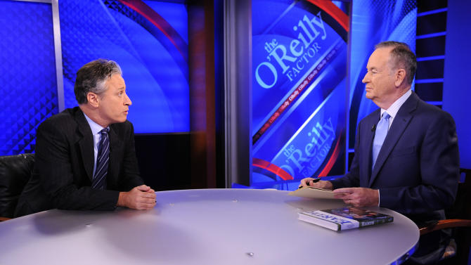 "FILE - This Sept. 22, 2010 file photo shows Comedy Central's Jon Stewart from ""The Daily Show with Jon Stewart,"" left, and and political pundit Bill O'Reilly during an interview for ""The O'Reilly Factor"" on FOX News Channel, in New York.  O'Reilly and Jon Stewart face off for a special 90-minute debate about the 2012 presidential race. The live debate will be streamed online on Oct. 6, 2012 from George Washington University in Washington, D.C. The price is $4.95, with one-half of the profits donated to a number of unspecified charities. (AP Photo/Peter Kramer, file)"