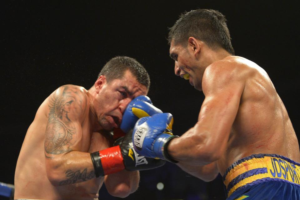Amir Khan, right, of Great Britain connects with Carlos Molina during their WBC silver super lightweight title bout, Saturday, Dec. 15, 2012, in Los Angeles.  (AP Photo/Mark J. Terrill)