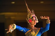 A Cambodian Apsara dancer performs during a ceremony at a hotel in Phnom Penh, December 17, 2012. Wrists bent and fingers curled, the immaculately dressed dancers perform a series of gestures that, according to ancient custom, carry the wishes of the Khmer kings to the heavens