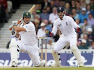 South African Captain Graeme Smith (L) hits a shot as England's wicketkeeper Matt Prior reacts at the Oval in London. South Africa were 403 for two in reply to England's first innings 385, a lead of 18 runs, at stumps on the third day