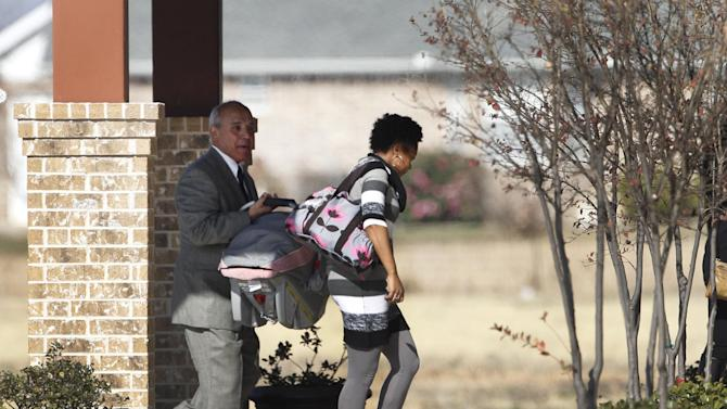 Mourners arrive at Ridgeview Family Fellowship Church for the funeral service of Kasandra Perkins, Thursday, Dec. 6, 2012, in Blue Ridge, Texas. Perkins was shot and killed last Saturday by her boyfriend Jovan Belcher, a Kansas City Chiefs football player. AP Photo/Tony Gutierrez)