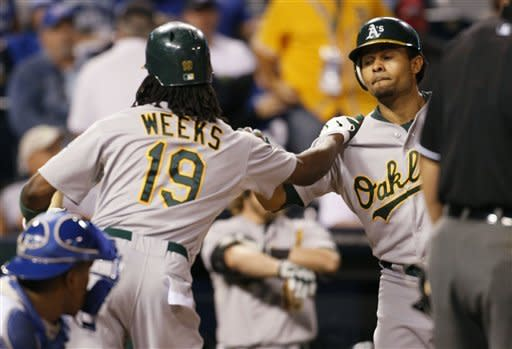 Crisp, Cespedes homer to lead A's over Royals