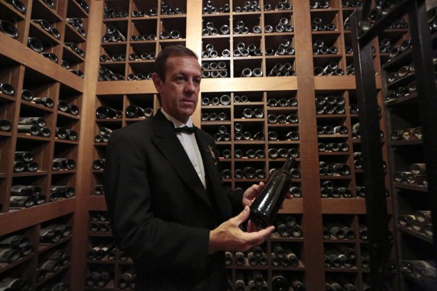 Patrice Frank, Chef sommelier of the Hotel de Paris presents a vintage 1835 Chateau d'Aligre at the Hotel de Paris in Monaco