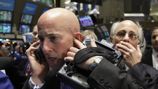 Traders Richard Genna, left, and Peter Tuchman work on the floor of the New York Stock Exchange Tuesday, Dec. 14, 2010. (AP Photo)