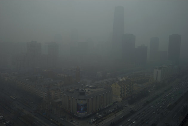 Skyscrapers are obscure by heavy haze in Beijing Sunday, Jan. 13, 2013. People refused to venture outdoors and buildings disappeared into Beijing's murky skyline on Sunday as the capital's air quality