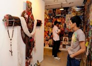 College students attend an exhibition at a government-run cultural centre in Manila. An art exhibit featuring a Jesus Christ poster with a wooden penis glued to His face has sparked protests in the mainly Catholic Philippines
