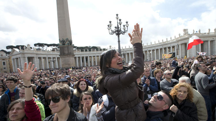 Faithful rejoice as Pope Francis delivers his Regina Coeli prayer from his studio window overlooking  St. Peter's Square at the Vatican, Monday, April 1, 2013. (AP Photo/Alessandra Tarantino)