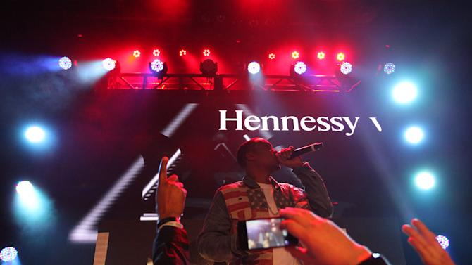 """Nas preforms at the Hennessy VS Presents """"Never Stop. Never Settle."""" Super Bowl 2013, on Sunday, Feb. 4, 2013 in New Orleans. (Photo by Omar Vega/Invision for Hennessy/AP Images)"""