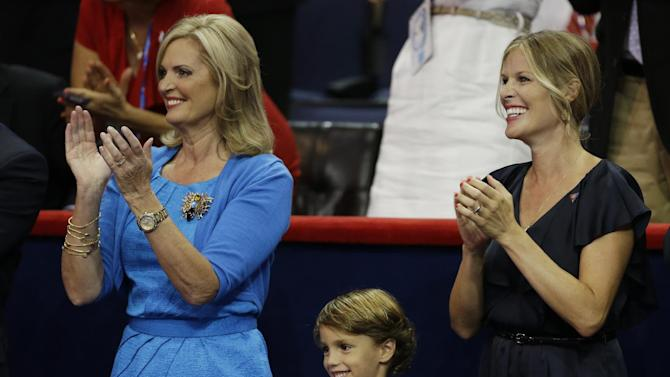 Ann Romney, wife of U.S. Republican presidential nominee Mitt Romney, left, and Craig Romney's wife Mary along with their son applaud after Craig's speech to delegates at the Republican National Convention in Tampa, Fla., on Thursday, Aug. 30, 2012. (AP Photo/Charlie Neibergall)