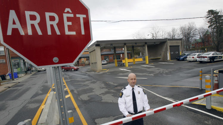 In this Nov. 14, 2012 photo, Miguel Begin, the chief of operations for the Canada Border Services Agency's Stanstead sector, stands at the Canadian port of entry in Stanstead, Quebec. Canadian immigration officials on Wednesday, Dec. 5, 2012 said a Romanian smuggling ring has been bringing Gypsies into the U.S. through Mexico in order for them to eventually gain asylum in Canada. Over the past year, cars loaded with ethnic Roma asylum seekers have run the border between Derby Line, Vermont and Stanstead. (AP Photo/Toby Talbot)