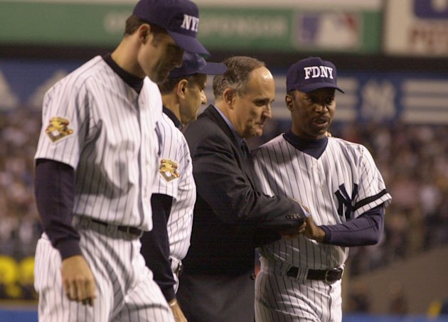 Former New York City Mayor Rudolph Giuliani shakes hands with Willie Randolph in the first baseball game played at Yankee Stadium after the 9/11terrorist attacks. (Ezra Shaw/Allsport/Getty Images)