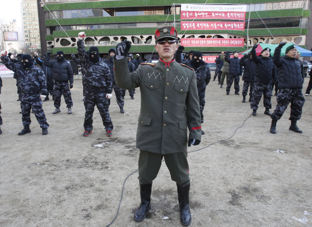 A veteran of South Korean Headquarters of Intelligence Detachment (HID), in a North Korean military uniform, shouts a slogan with his former comrades during a rally against South Korean government giving support to pro-North Korean groups in South Korea near the City Hall in Seoul, South Korea, Friday, Jan. 25, 2013. South Korea&#39;s President Park Geun-hye is strongly urging North Korea to refrain from conducting a nuclear test that could only worsen the tensions on the Korean Peninsula in the wake of a provocative long-range rocket launch in December, envoy Rhee In-je told The Associated Press and selected news outlets in Davos, Switzerland. (AP Photo/Ahn Young-joon) (AP Photo/Ahn Young-joon)