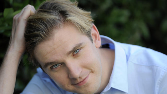 "FILE - In this July 31, 2011 file photo, actor Dan Stevens poses for a portrait, in Beverly Hills, Calif.  Stevens, who is currently shooting the third season of ""Downton Abbey,"" is joining the cast of Broadway's ""The Heiress."" Producers said Sunday, May 13, 2012 that Stevens, who plays the aristocratic Matthew Crawley on the hit PBS show, will make his Broadway debut opposite Jessica Chastain and David Strathairn. (AP Photo/Chris Pizzello, File)"