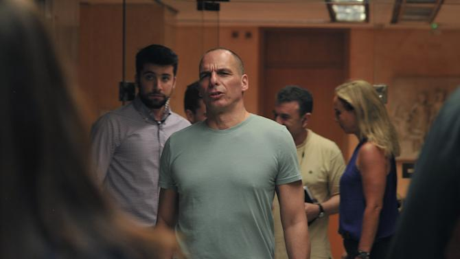Greece's Finance Minister Yanis Varoufakis arrives to makes statements at the Finance Ministry after the results of referendum in Athens, Sunday, July 5, 2015. Greece faced an uncharted future as its interior ministry predicted Sunday that more than 60 percent of voters in a hastily called referendum had rejected creditors' demands for more austerity in exchange for rescue loans. (AP Photo/Angelos Christofilopoulos)